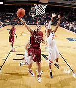 Nov 6, 2010; Charlottesville, VA, USA; Roanoke College Clay Lacy (24) shoots the ball next to Virginia Cavaliers f Akil Mitchell (25) Saturday afternoon in exhibition action at John Paul Jones Arena. The Virginia men's basketball team recorded an 82-50 victory over Roanoke College.