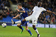 Cardiff City's Joe Ralls (l) is challenged by Leeds United's Souleymane Doukara. Skybet football league championship match, Cardiff city v Leeds Utd at the Cardiff city stadium in Cardiff, South Wales on Tuesday 8th March 2016.<br /> pic by Carl Robertson, Andrew Orchard sports photography.