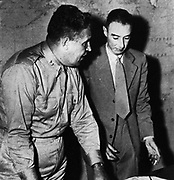 General Leslie Groves (left), military head of the Manhattan Project, with Prof. Robert Oppenheimer (right)