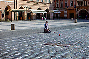 A young man praying. On Monday the 22nd of March 25,000 white crosses appeared in the Old Town Square in Prague. Each of these crosses is said to symbolize the death of a person from Covid-19. The number of victims since the beginning of the epidemic in the Czech Republic has already exceeded 25000.