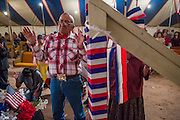 "13 JULY 2012 - FT DEFIANCE, AZ: A man prays at the alter call at the 23rd annual Navajo Nation Camp Meeting in Ft. Defiance, north of Window Rock, AZ, on the Navajo reservation. Preachers from across the Navajo Nation, and the western US, come to Navajo Nation Camp Meeting to preach an evangelical form of Christianity. Evangelical Christians make up a growing part of the reservation - there are now more than a hundred camp meetings and tent revivals on the reservation every year. The camp meeting in Ft. Defiance draws nearly 200 people each night of its six day run. Many of the attendees convert to evangelical Christianity from traditional Navajo beliefs, Catholicism or Mormonism. ""Camp meetings"" are a form of Protestant Christian religious services originating in Britain and once common in rural parts of the United States. People would travel a great distance to a particular site to camp out, listen to itinerant preachers, and pray. This suited the rural life, before cars and highways were common, because rural areas often lacked traditional churches. PHOTO BY JACK KURTZ"