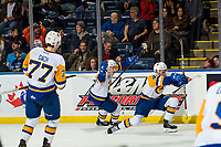 KELOWNA, BC - DECEMBER 01:  Gary Haden #14 and Dawson Davidson #4 of the Saskatoon Blades celebrate the overtime winning goal against the Kelowna Rockets at Prospera Place on December 1, 2018 in Kelowna, Canada. (Photo by Marissa Baecker/Getty Images)