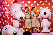 17 DECEMBER 2014 - BANGKOK, THAILAND: Thai Girl Scouts pose for pictures with Snoopies in the Christmas display at Central World in Bangkok. Thailand is overwhelmingly Buddhist. Christmas is not a legal holiday in Thailand, but Christmas has become an important commercial holiday in Thailand, especially in Bangkok and communities with a large expatriate population.    PHOTO BY JACK KURTZ