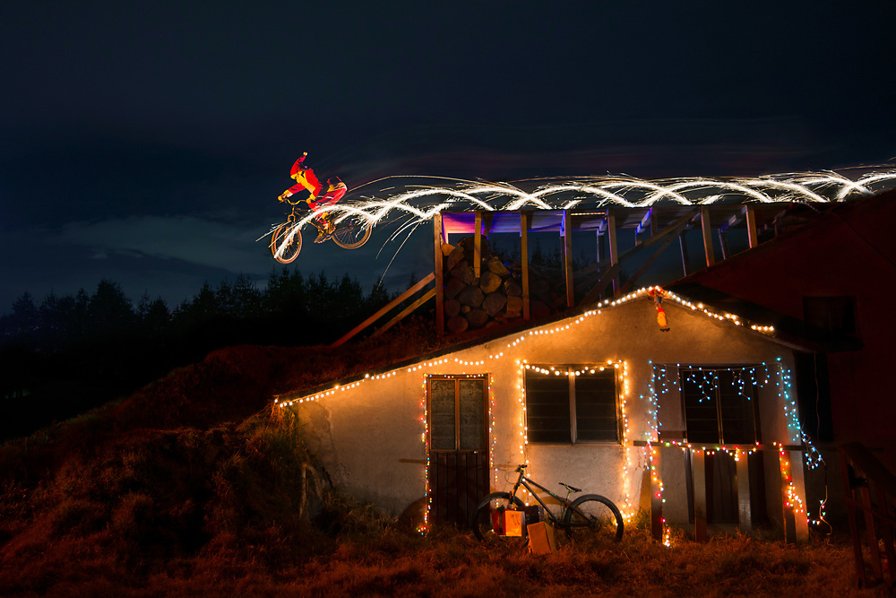 Santa Claus clears a roof and takes flight, while sparkles fly out of his bike. Personal project