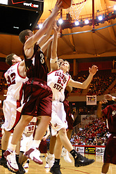01 January 2006..Matt Shaw gets a hand on a Mark Kruse shot. Levi Dyer goes up behind Shaw to try and get the tip in...The Southern Illinois Saluki's chewed up the Illinois State Redbirds with 37 points in the 2nd half to beat the birds with a final score of 65-52.  An audience of just over 7500 watched the in Redbird Arena on the campus of Illinois State University in Normal Illinois.....