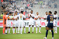 Players applaud the health workers who fight the covid-19 before the French Ligue Cup final match between Paris Saint-Germain (PSG) and Olympique Lyonnais (OL, Lyon) on July 31, 2020 at the Stade de France, in Saint-Denis, near Paris, France - Photo Juan Soliz / ProSportsImages / DPPI