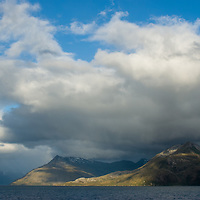 Clouds and sun over Magdalena Channel, Tierra del Fuego, Chile.