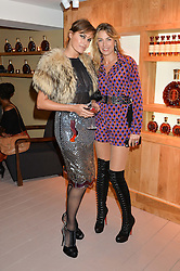 Left to right, YASMIN LE BON and ASSIA WEBSTER at the launch of La Maison Remy Martin based at 19 Greek Street, London on 24th November 2014.