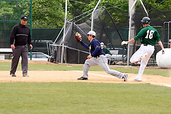 28 April 2012:  Jon Frericks gets tossed out at first base during an NCAA division 3 Baseball game between the Augustana Vikings and the Illinois Wesleyan Titans in Jack Horenberger Stadium, Bloomington IL