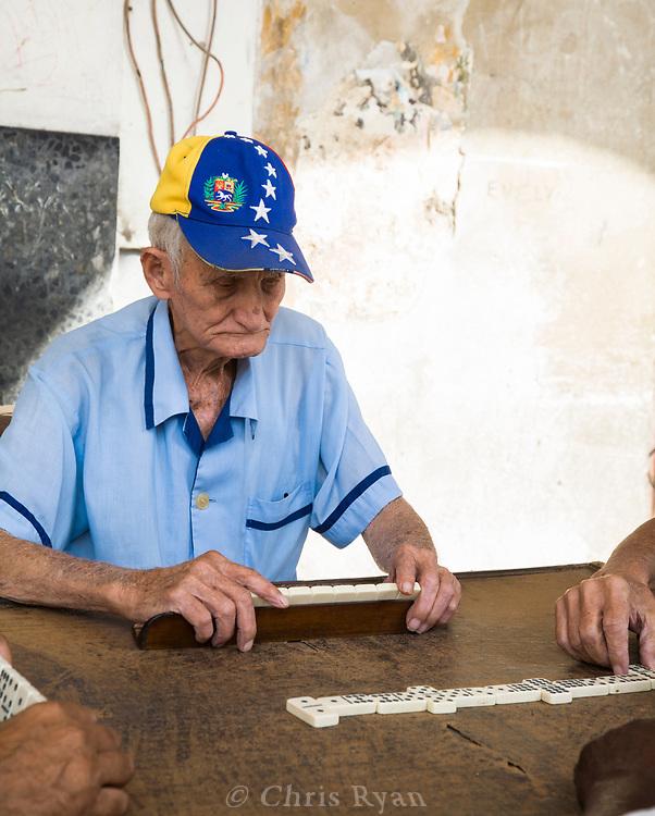 Men playing dominoes in the streets, Havana, Cuba