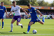 AFC Wimbledon midfielder Callum Reilly (33) with a shot on goal during the EFL Sky Bet League 1 match between AFC Wimbledon and Shrewsbury Town at the Cherry Red Records Stadium, Kingston, England on 14 September 2019.