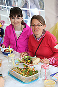 Ita Reddington and Coralie Maureau enjoying the Street Feast at the opening of the Galway Bike Festival on Saturday. Photo:-XPOURE.IE / NO FEE