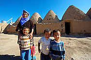 """Pictures of the beehive adobe buildings of Harran, south west Anatolia, Turkey.  Harran was a major ancient city in Upper Mesopotamia whose site is near the modern village of Altınbaşak, Turkey, 24 miles (44 kilometers) southeast of Şanlıurfa. The location is in a district of Şanlıurfa Province that is also named """"Harran"""". Harran is famous for its traditional 'beehive' adobe houses, constructed entirely without wood. The design of these makes them cool inside. 28 .<br /> <br /> If you prefer to buy from our ALAMY PHOTO LIBRARY  Collection visit : https://www.alamy.com/portfolio/paul-williams-funkystock/harran.html<br /> <br /> Visit our TURKEY PHOTO COLLECTIONS for more photos to download or buy as wall art prints https://funkystock.photoshelter.com/gallery-collection/3f-Pictures-of-Turkey-Turkey-Photos-Images-Fotos/C0000U.hJWkZxAbg ."""