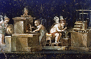 Excavations at Pompei:  Wall painting from the House of the Vetti showing cupids as goldsmiths, uncovered during the excavations. Pompei was destroyed by the eruption of Vesuvius in 79 AD.