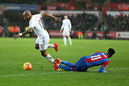 Andre Ayew of Swansea city appears to be fouled in the penalty area by Wilfried Zaha of Crystal Palace but no penalty is awarded. Barclays Premier league match, Swansea city v Crystal Palace at the Liberty Stadium in Swansea, South Wales on Saturday 6th February 2016.<br /> pic by Andrew Orchard, Andrew Orchard sports photography.