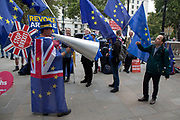 On the day that Parliament was suspended for five weeks, anti-Brexit protester Steve Bray speaks to a persistent pro-European protester outside the Cabinet Office in Westminster as inside Tory ministers gather on 10th September 2019 in London, England, United Kingdom.