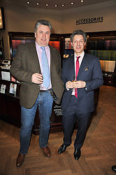 Left to right, PAUL NICHOLLS and Thomas Pink CEO JONATHAN HEILBRON at a party to celebrate the paperback publication of Lucky Break by leading trainer Paul Nicholls held at Thomas Pink, 85 Jermyn Street, London on 23rd February 2011.
