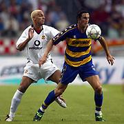 Manchester United's Rio Ferdinand and Parma's Emiliano Bonazolli battle for the ball
