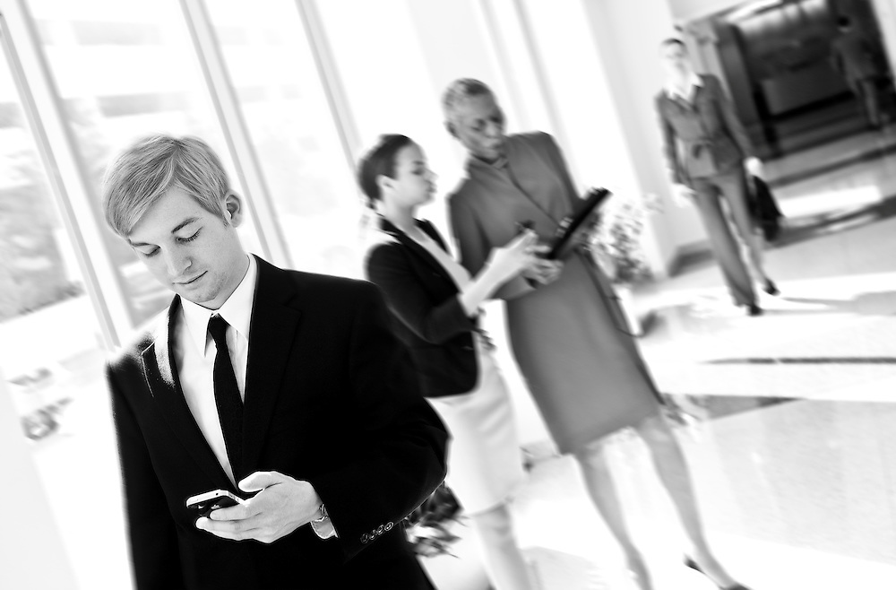 checking email on smartphone in hallway