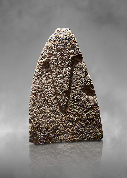 Top section of a Late European Neolithic prehistoric Menhir standing stone with carvings on its face side. The representation of a stylalised male figure starts at the top with a long nose from which 2 eyebrows arch around the top of the stone. Excavated from Amassed VII, Allai. Menhir Museum, Museo della Statuaria Prehistorica in Sardegna, Museum of Prehoistoric Sardinian Statues, Palazzo Aymerich, Laconi, Sardinia, Italy .<br /> <br /> Visit our PREHISTORIC PLACES PHOTO COLLECTIONS for more photos to download or buy as prints https://funkystock.photoshelter.com/gallery-collection/Prehistoric-Neolithic-Sites-Art-Artefacts-Pictures-Photos/C0000tfxw63zrUT4