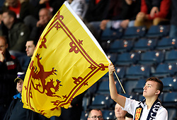 A Scotland fan in the stands waves a flag before kick off during the UEFA Nations League, League C Group one match at Hampden park, Glasgow.