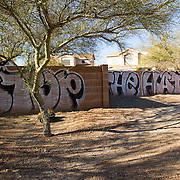 Graffiti sprayed near the funeral service for slain 9 year old Christina Green who died in the shooting rampage on January 8, 2011 in Tucson, Arizona.