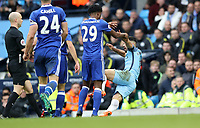 Football - 2016 / 2017 Premier League - Manchester City vs. Chelsea<br /> <br /> Sergio Aguero of Manchester City is pushed over by Nathaniel Chalobah of Chelsea during the match at The Ethiad.<br /> <br /> COLORSPORT/LYNNE CAMERON