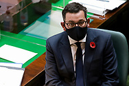 Daniel Andrews wears a mask in the chamber as he looks on during Question Time.