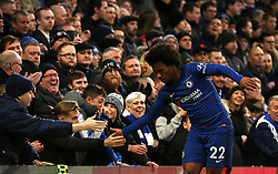 Chelsea's Willian shakes hands with fans in the stands