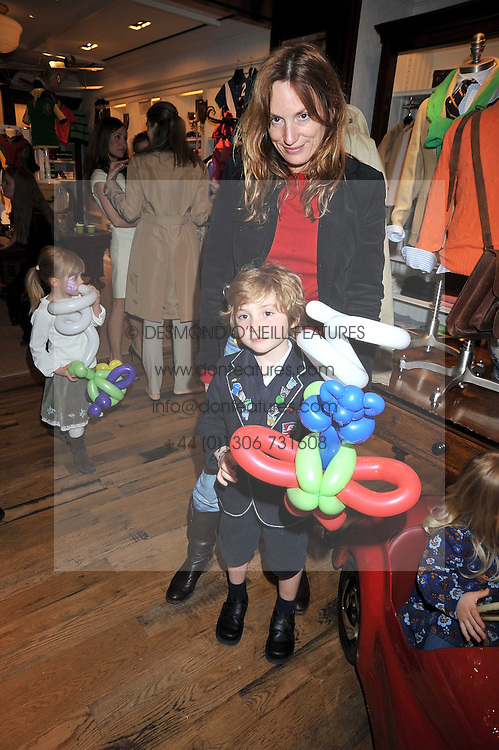 EMILY OPPENHEIMER-TURNER and her son THEO TURNER at 'Paint Your Polo Celebration' a children's party in aid of the charity Clic Sargent held at Ralph Lauren, 139/141 Fulham Road, London on 28th April 2009.