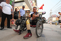 June 12, 2017 - China - Heze, CHINA-June 12 2017: (EDITORIAL USE ONLY. CHINA OUT)..Zhang Qingli, a legless man from Heze, east China's Shandong Province, has been traveling around the world since 2005. Zhang lost his legs at his childhood. He started his journey around China after he was inspired by a story of an old man who cycled around China in 2005. Now Zhang has been to Thailand, Indonesia and Laos. He dreamed to enjoy beautiful scenery of the junction of Atlantic and Indian Ocean at the Cape of Good Hope in South Africa. (Credit Image: © SIPA Asia via ZUMA Wire)