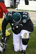 PHILADELPHIA - DECEMBER 30: William Thomas #72 of the Philadelphia Eagles prays for a moment after the game against the Buffalo Bills on December 30, 2007 at Lincoln Financial Field in Philadelphia, Pennsylvania. The Eagles won 17-9.