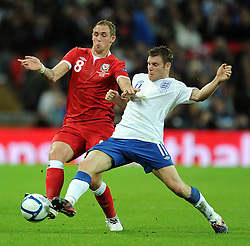 06.09.2011, Wembley Stadium, London, GBR, UEFA EURO 2012, Qualifikation, England vs Wales, im Bild Wales' Jack Collison and England's James Milner during the UEFA Euro 2012 Qualifying Group G match at Wembley Stadium on 6/9/2011. EXPA Pictures © 2011, PhotoCredit: EXPA/ Propaganda Photo/ Chris Brunskill +++++ ATTENTION - OUT OF ENGLAND/GBR+++++