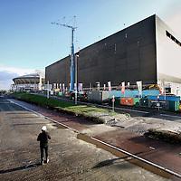 Nederland, Amsterdam , 6 december 2011..Ziggo Dome.Naast de Amsterdam ArenA verschijnt een nieuwe concerthal, met ruimte voor 15.600 bezoekers. Begin 2012 opent de Ziggo Dome haar deuren..De programmering bestaat uit concerten van nationale en internationale artiesten, family entertainment en andere evenementen. Het aanbod is divers en geschikt voor een breed publiek. In de Ziggo Dome worden ongeveer 100 evenementen per jaar georganiseerd. Het verwachte jaarlijkse bezoekersaantal is 1,2 miljoen...Het ontwerp van de Ziggo Dome is in handen van Benthem Crouwel Architekten bna...Next to the Amsterdam ArenA a new concert hall is being built with space for 15,600 visitors. Early 2012 the Ziggo Dome opens its doors.