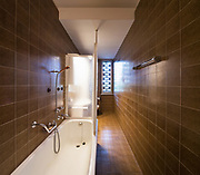 Vintage bathroom in the apartment to be renovated with green tiles. Nobody inside