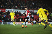 Brentford midfielder Sam Saunders driving forward to score opening goal during the Sky Bet Championship match between Brentford and Leeds United at Griffin Park, London, England on 26 January 2016. Photo by Matthew Redman.