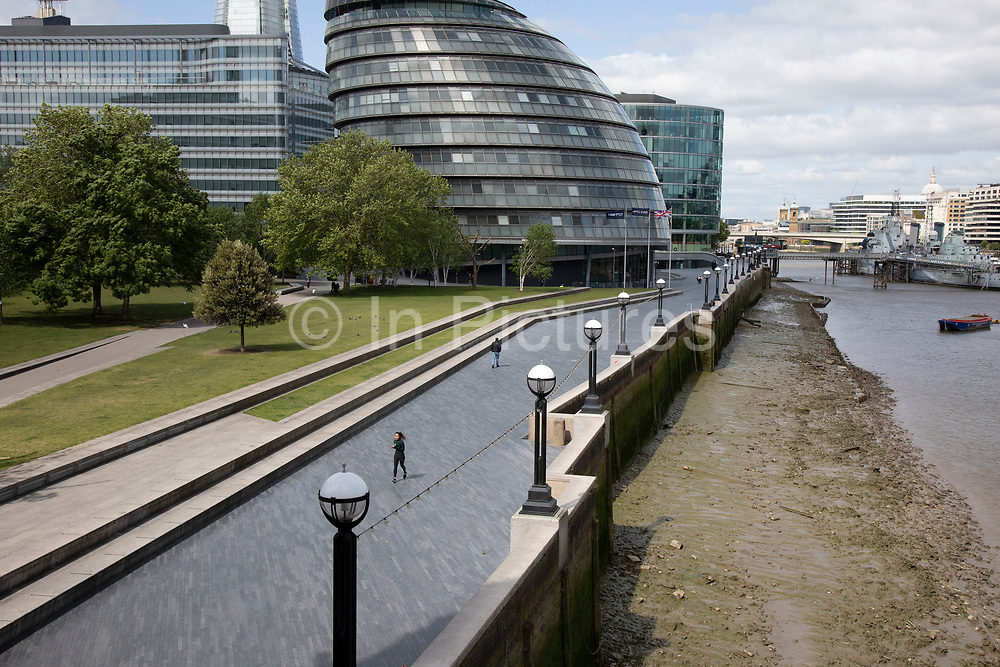 More London looking towards City Hall adjacent to the River Thames, which is normally bustling with tourists is eerily quiet and silent on empty streets as lockdown continues and people observe the stay at home message in the capital on 11th May 2020 in London, England, United Kingdom. Coronavirus or Covid-19 is a new respiratory illness that has not previously been seen in humans. While much or Europe has been placed into lockdown, the UK government has now announced a slight relaxation of the stringent rules as part of their long term strategy, and in particular social distancing.