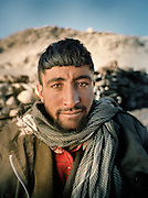 """Assan Khan..Wakhi winter shepherds known as """"Shpunds"""" in their settlement of Kher Metek, on the edge of the Little Pamir. They often look over Kyrgyz sheep and yak herds for payment in animals. .Winter expedition through the Wakhan Corridor and into the Afghan Pamir mountains, to document the life of the Afghan Kyrgyz tribe. January/February 2008. Afghanistan"""