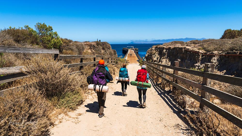 Hikers at the Beechers Bay pier, Santa Rosa Island, Channel Islands National Park, California USA