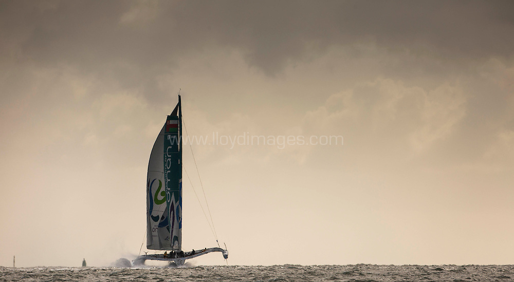 The Seven Star Round Britain and Ireland, race start. Cowes. Isle of Wight. The Oman Sail MOD70 trimaran in action, skippered by Sidney Gavignet (FRA)<br /> Please Credit: Lloyd Images