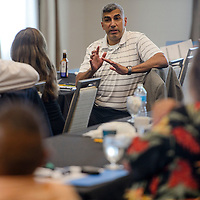 Michael Conejo turns in his chair for a discussion with the other attendees during a behavioral health forum at the Hilton Garden Inn in Gallup Thursday.