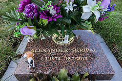 © Licensed to London News Pictures. 07/03/2018. Salisbury, UK. A toy dog and floaral tributes decorate the grave of Alexander Skripal son of former Russian spy Sergei Skripal who has become ill, along with his daughter Yulia, with suspected poisoning in Salisbury, England. The couple where found unconscious on bench in Salisbury shopping centre. Specialist units have been called in to deal with any possible contamination. Photo credit: Peter Macdiarmid/LNP