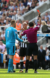 13 August 2017  : Premier League Football : Newcastle United v Tottenham Hotspur:  Jonjo Shelvey is shown the red card by referee Andre Marriner: Photo: Mark Leech