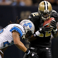 January 7, 2012; New Orleans, LA, USA; New Orleans Saints wide receiver Marques Colston (12) is hit by Detroit Lions safety Louis Delmas (26) during the 2011 NFC wild card playoff game at the Mercedes-Benz Superdome. Mandatory Credit: Derick E. Hingle-US PRESSWIRE