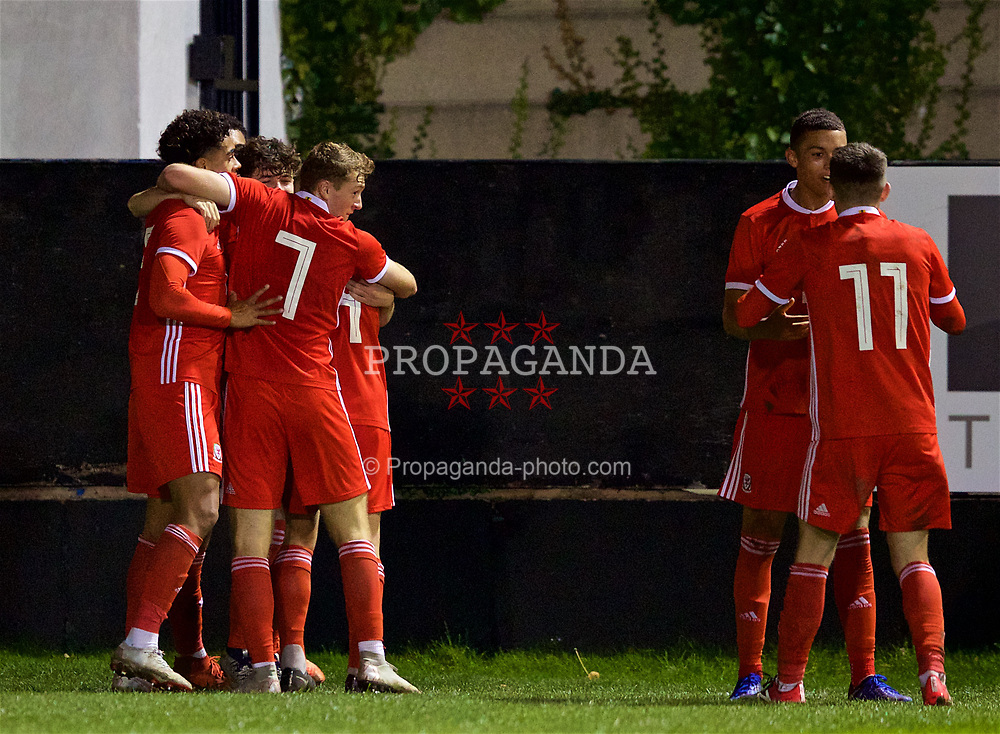 RHYL, WALES - Wednesday, November 14, 2018: Wales' Neco Williams celebrates scoring the first goal with team mates during the UEFA Under-19 Championship 2019 Qualifying Group 4 match between Wales and Scotland at Belle Vue. Luke Jephcott, captain Ryan Reynolds, Christian Norton Joseph Adams, Brennan Johnson (Pic by Paul Greenwood/Propaganda)