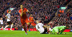 09.11.2013, Anfield, Liverpool, ENG, Premier League, FC Liverpool vs FC Fulham, 11. Runde, im Bild Liverpool's Luis Suarez celebrates scoring the fourth goal against Fulham, his hat-trick third goal, // during the English Premier League 11th round match between Liverpool FC and Fulham FC at Anfield in Liverpool, Great Britain on 2013/11/09. EXPA Pictures © 2013, PhotoCredit: EXPA/ Propagandaphoto/ David Rawcliffe<br /> <br /> *****ATTENTION - OUT of ENG, GBR*****
