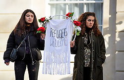 """© Licensed to London News Pictures. 04/02/2017. London, UK. Two women hold up a banner reading """"REFUGEES WELCOME"""" as housand of protestors take part in a demonstration against U.S President Donald Trump's Executive Order banning refugees and immigrants from a number of Muslim-majority countries. Protestors join campaign groups including Stop the War, Stand up to Racism, Muslim Association of Britain, in a march from the U.S Embassy in London to Downing Street. Photo credit: Ben Cawthra/LNP"""