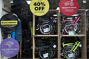 A detal of Brompton fold-up bikes on display with their prices in the window of the Farringdon Road branch of Evans Cycles, on 20th November, in the City of London, England.