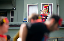 A woman and her children get into the B2B spirit as they cheer on the runners from their veranda on Fell Street, at the 107th running of the Bay to Breakers, Sunday, May 20, 2018, in San Francisco. (Photo by D. Ross Cameron)