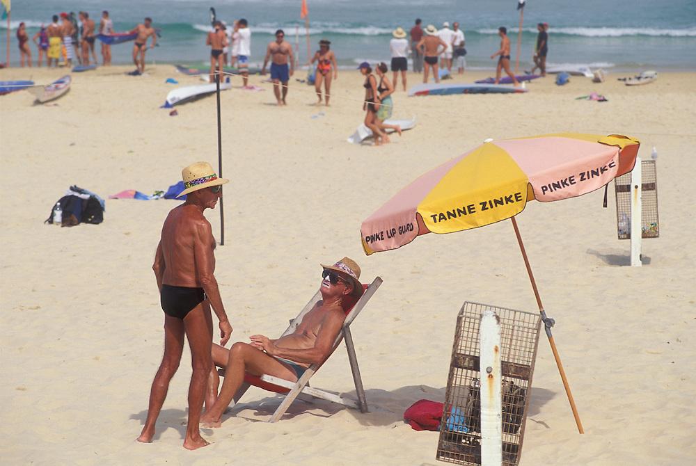Australia, NSW, Sunbathers at Bondi Beach near Sydney on a sunny afternoon.